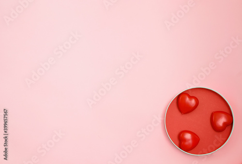 Happy Valentine's Day or Mother's Day greeting card with red hearts on pink background.Banner for your store or website.Copy space.Flat lay.Mock up