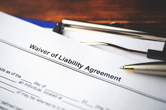 Legal document Waiver of Liability Agreement on paper close up