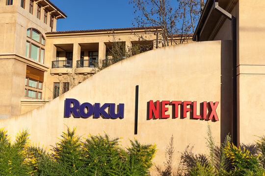 Los Gatos, California, USA - March 29, 2018: Netflix and Roku signs at headquarters in Los Gatos, California.