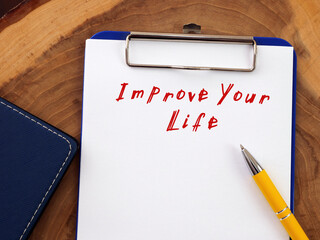 Improve Your Life phrase on the piece of paper.
