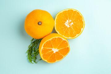 top view fresh tangerine slices on light-blue background photo fruit citrus orange color