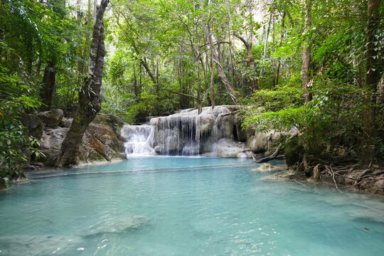 Photo picture of a fascinating view Thailand waterfall and the azure water with colors on the sun
