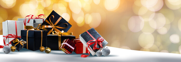 Celebration theme with christmas gifts golden background