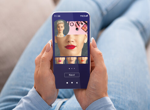 Augmented Reality Beauty App. Woman Trying Different Lipstick Color Makeup On Smartphone