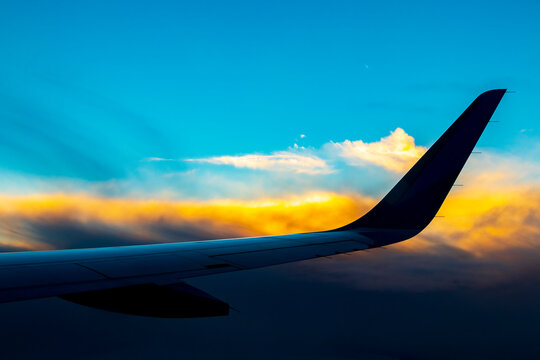 Flying over Europe to Mallorca at beautiful colorful sunset.