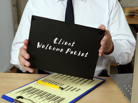 Business concept meaning Client Welcome Packet with inscription on the piece of paper.
