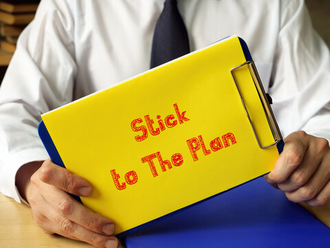 Financial concept meaning Stick to The Plan with inscription on the piece of paper.