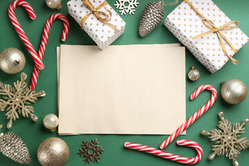 Flat lay composition with blank sheets of paper on green background, space for text. Writing letter to Santa