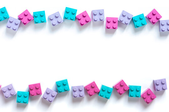 Colored toy bricks on white background