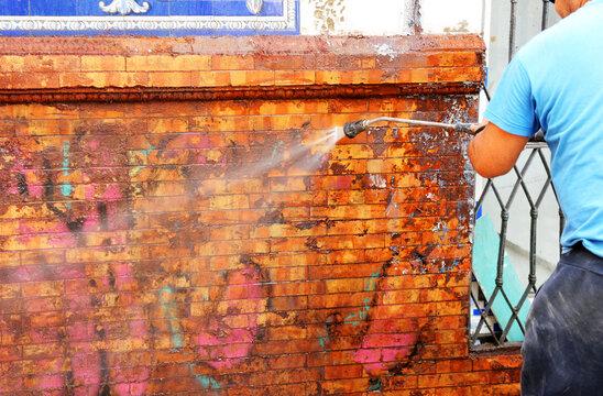 clean graffiti with high pressure water