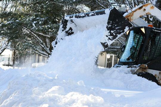 Cleaning after snowstorm Skid-Steer Loader