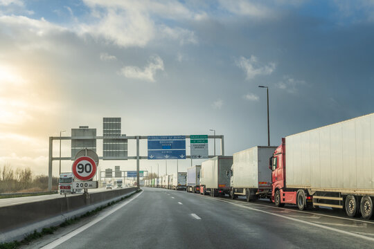 Calais, France - December  17, 2020 : As brexit approaches, lines of trucks at the entrance to the Channel Tunnel