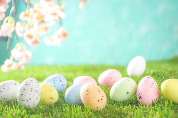 Happy Easter background, spring-time concept. Colorful pastel eggs, nests and bunny toys on  sunny...