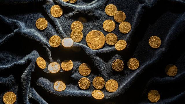 Treasure of ancient gold coins. Cash, money. Business concept.