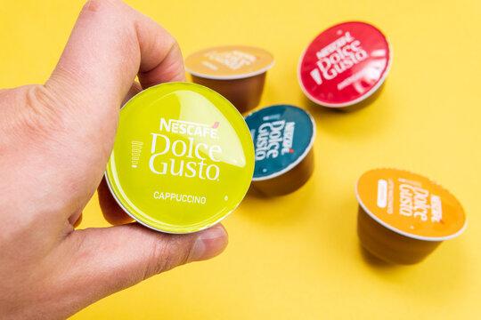 Tyumen, Russia-December 10, 2020: Nescafe Dolce Gusto Cappuccino capsule. coffee at home.