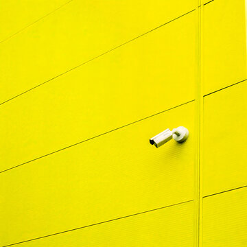 Yellow Wall with Security Camera