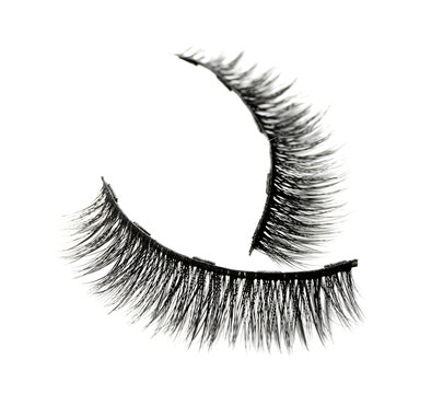 Pair of magnetic eyelashes on white background