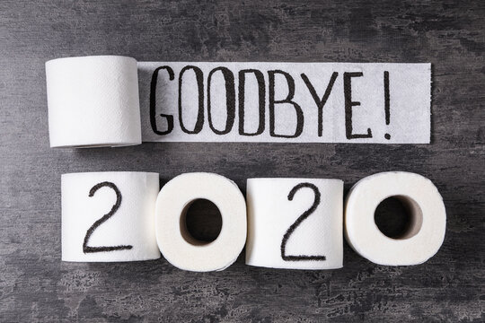 Text Goodbye 2020 made with toilet paper on grey stone background, flat lay