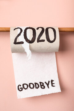 Toilet paper roll with text Goodbye 2020 on pink background