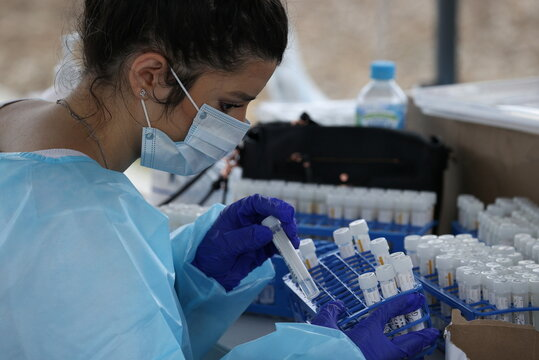 A medical professional works at a drive-through coronavirus disease testing clinic in Sydney