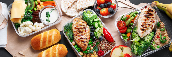 Takeaway lunch boxes with homemade nutrition food - meat, vegetables and fruits.