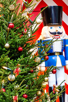 Christmas tree and traditional nutcracker at the entrance of a shop at Christmas Market in medieval town of Rothenburg ob der Tauber, Bavaria, Germany