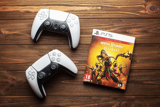 Two dualsense ps5 controllers and mortal kombat game