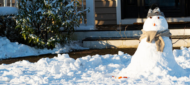 Snow man built in front yard after snow fall