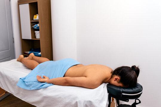 Woman lying on stretcher