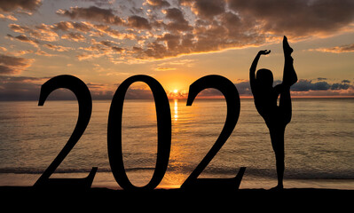 New Year 2021 at Beach Sunrise Silhouette of Woman Dancing