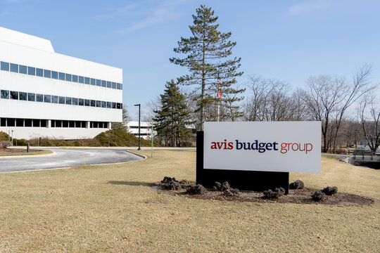 New Jersey, USA - January 27, 2019: Avis Budget Group sign and building at the entrance to their headquarters in New Jersey. Avis Budget Group, Inc. is the American parent car rental company.