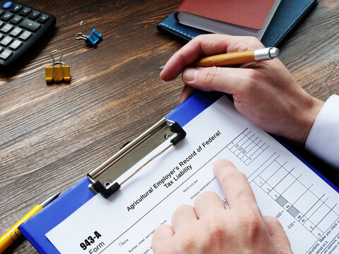 Form 943-A Agricultural Employer's Record of Federal Tax Liability inscription on the sheet.