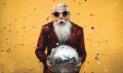 Crazy senior man having fun doing party during holidays time - Elderly people celebrating life...