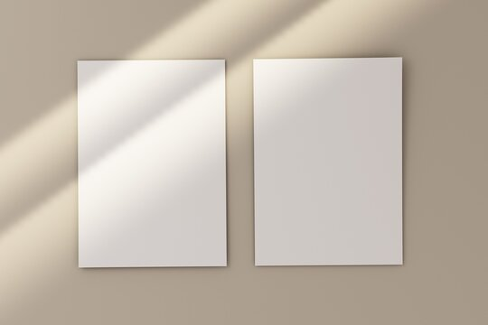 Blank white 5x7 card on white floor with rays of sunlight