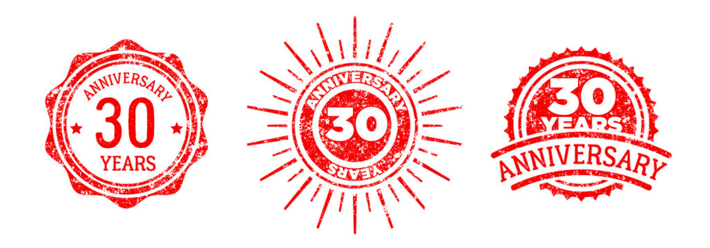 A group of 30 years anniversary logos drawn in the form of stamps, red frames for celebration. Grunge rubber stamp texture. Holiday stamps. Collection of postage stamps. Vector round stamps