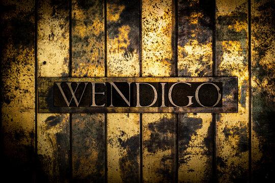 Wendigo text on grunge textured copper and gold background
