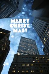 Fotobehang - Merry Christmas greeting text in beautiful winter snowfall sky seen through city skyscrapers skyline in downtown Manhattan, New York.