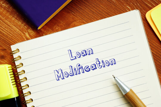 Business concept about Loan Modification with phrase on the sheet.