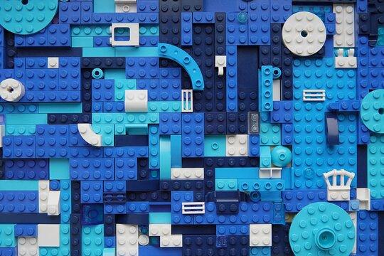 Blue plastic building details mosaic background, lego art, pattern., boys toys.