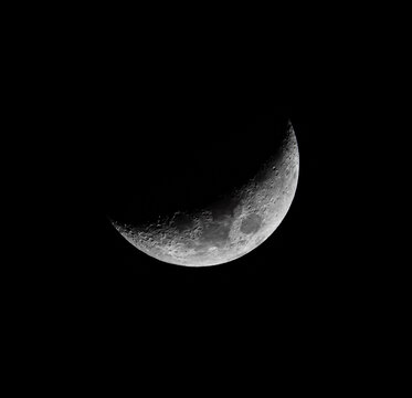 Craters Visible on the Lunar Landscape seen on a Crescent Moon