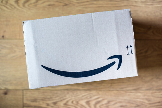 Amazon delivery box on wooden floor inside house