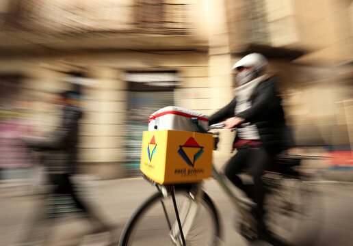 Geraldine Caillaud, member of the bicycle delivery company Les Mercedes, rides in Barcelona