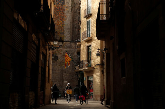 Geraldine Caillaud, member of the bicycle delivery company Les Mercedes, rides through gothic area in Barcelona