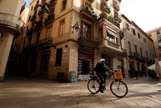 Geraldine Caillaud, member of the bicycle delivery company Les Mercedes, rides through gothic area at Barcelona's city center