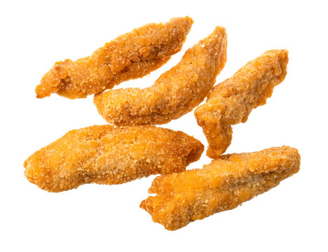 several chicken strips (breaded and deep fried pieces of chicken meat) isolated on white background