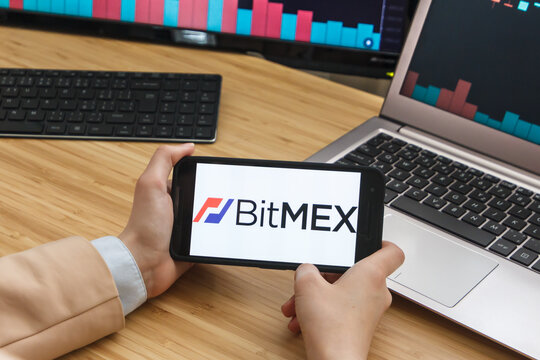 SAN FRANCISCO, US - 18 May 2019: Female Trader Hands Holding the Smartphone Using Application of BitMex Cryptocurrency Exchange Market. San Francisco, California, USA.