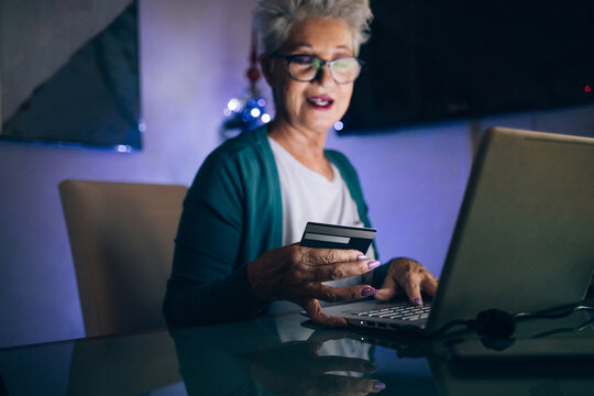 Woman Christmas shopping online with credit card