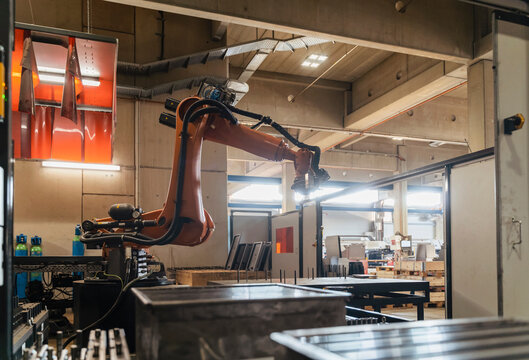 Automated robotic arms in manufacturing factory
