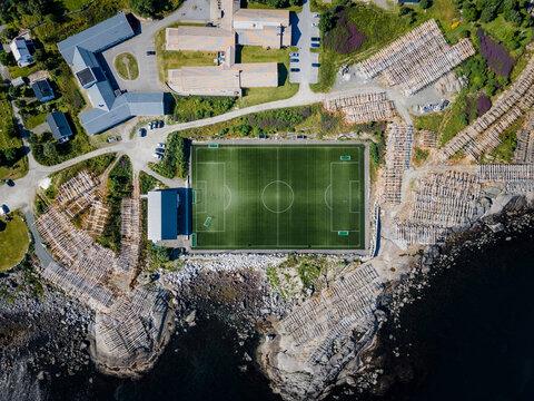 Sports field by building at Reine, Lofoten, Norway