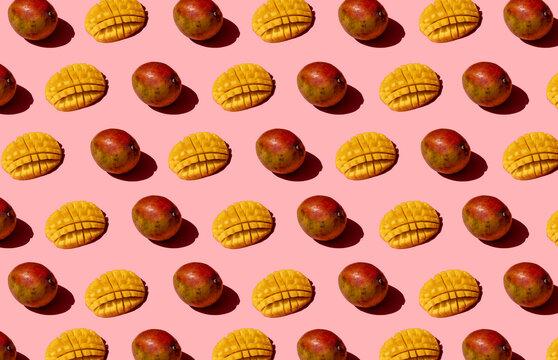 Whole and chopped mango pattern on pink background